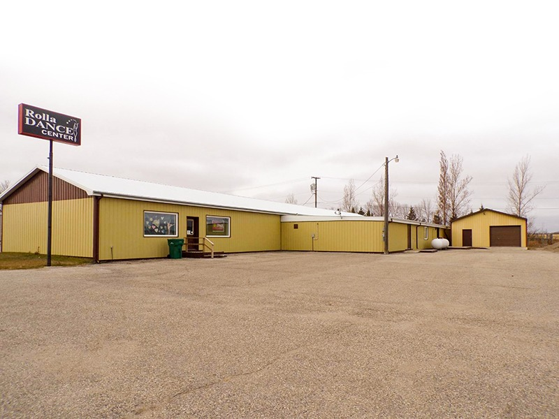 exterior of large yellow warehouse building at 802 Main Ave